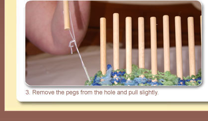 3. Remove the pegs from the hole and pull slightly